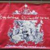 Rotes Plakat mit Zeichnung und Aufschrift